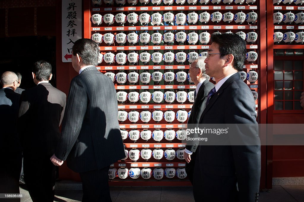 People enter the main shrine at the Kanda Myojin shrine to offer their prayers on the first day of business in 2013 in Tokyo, Japan, on Friday, Jan. 4, 2013. Japan's deflation-plagued economy has contracted 7 percent since 2007 as six prime ministers, including Shinzo Abe in his first term, failed to reverse the course. Photographer: Noriko Hayashi/Bloomberg via Getty Images