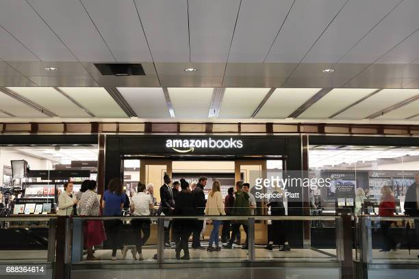 People enter the newly opened Amazon Books on May 25 2017 in New York City Amazoncom Inc's first New York City bookstore occupies 4000 square feet in...