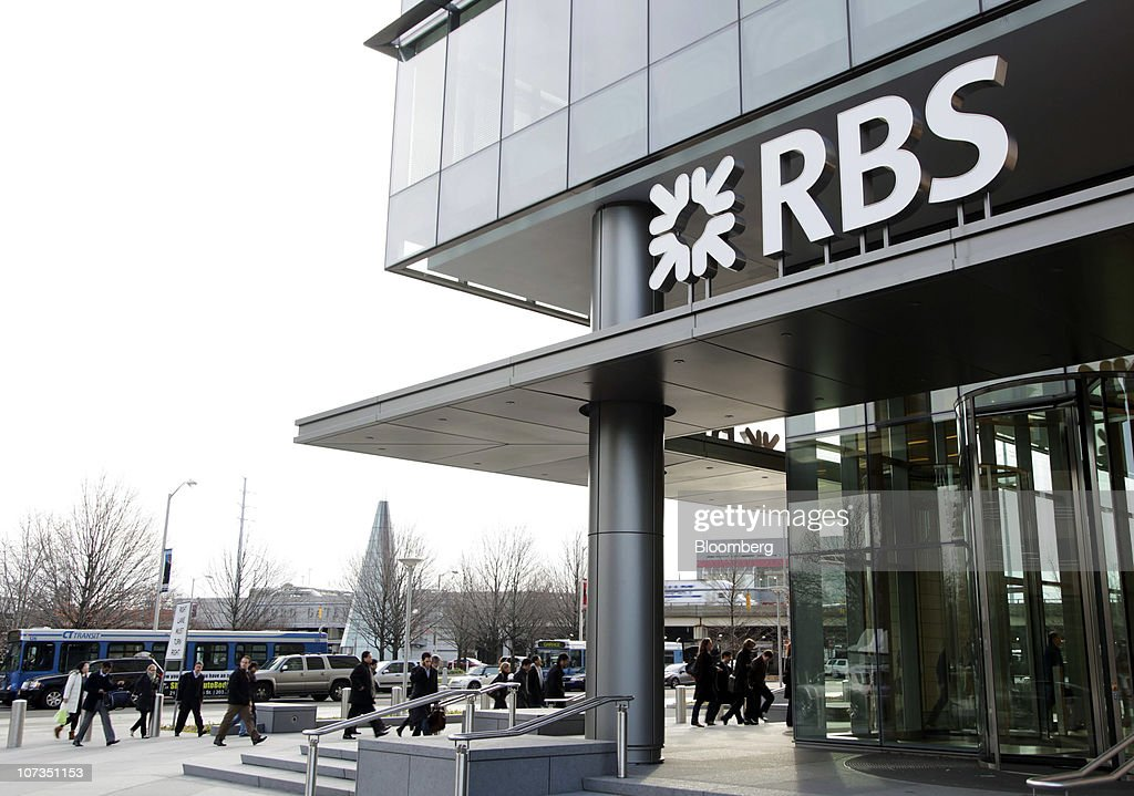 People enter the offices of RBS Securities Inc in Stamford Connecticut US on Friday Dec 3 2010 UK Chancellor of the Exchequer George Osborne may sell...