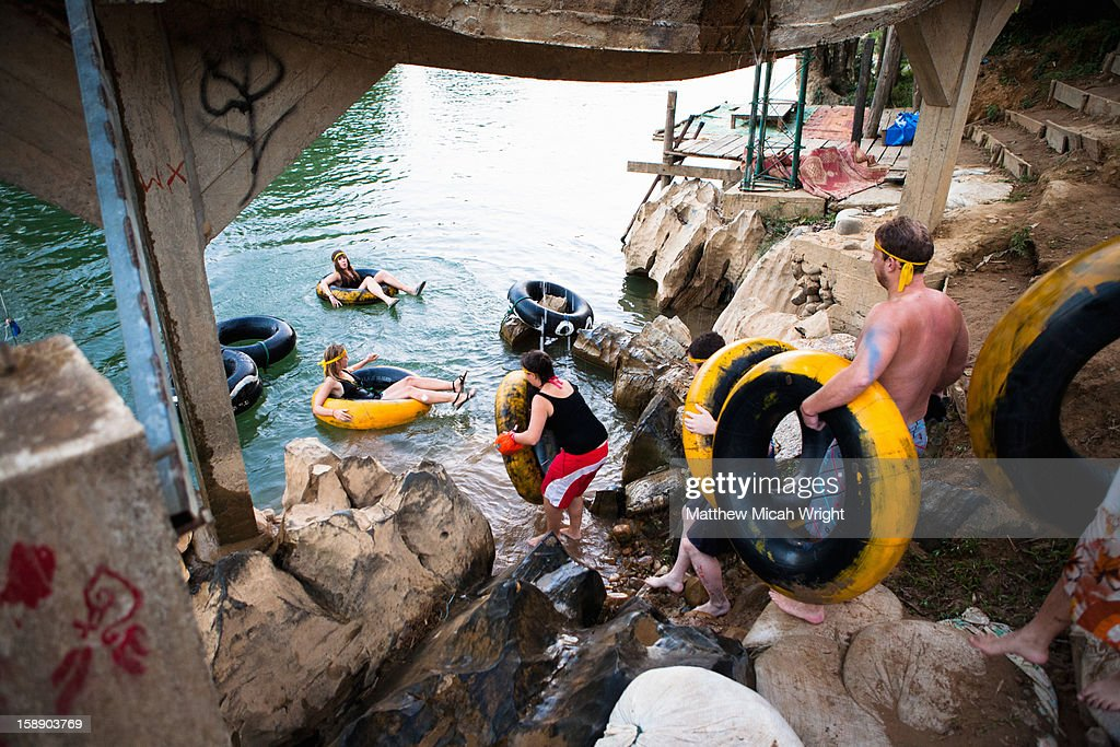 People enter the river in an inner tube