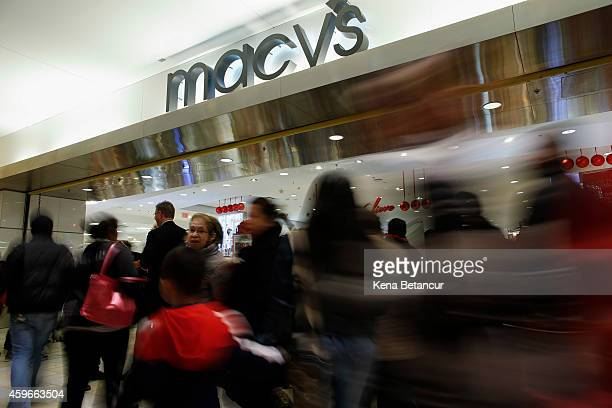 People enter to Macy's store at the Newport Mall on November 27 2014 in Jersey City New Jersey Black Friday sales which now begin on the Thursday of...