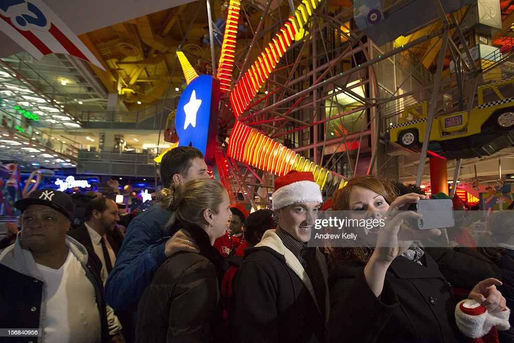 People enter Toys R Us for the Black Thursday sale in Times Square November 22, 2012 in New York City.The store got a head start on the traditional Black Friday sales by opening their doors at 8pm on Thanksgiving night.