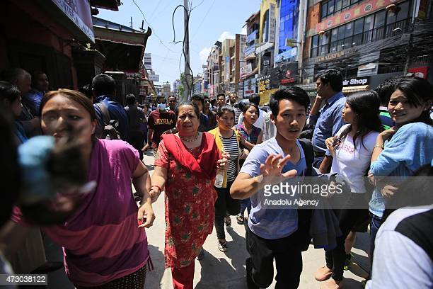 People escape after a magnitude 73 earthquake has hit Nepal as the country recovers from last month's devastating earthquake in Kathmandu Nepal on...
