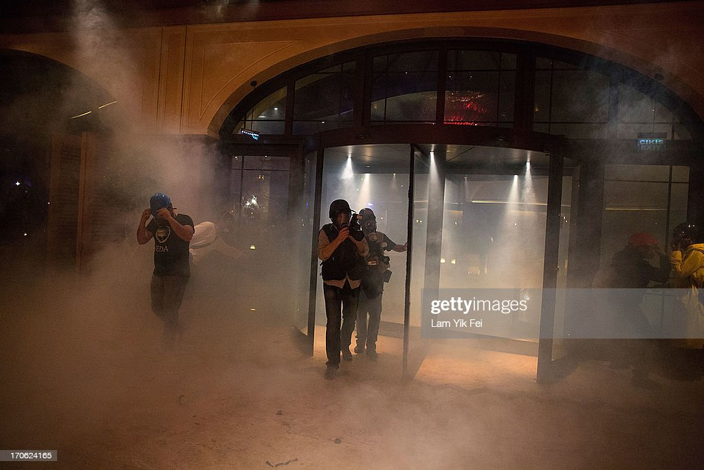 People escape to the Divan Istanbul Hotel as riot police fire tear gas to disperse the crowd near the Gezi Park on June 15, 2013 in Istanbul, Turkey. Istanbul has seen protests rage on for days, with two protesters and one police officer killed. What began as a protest over the fate of Taksim Gezi Park turned into a wider demonstration over Prime Minister Recep Tayyip Erdogan's policies. Erdogan has delivered a final warning after a 24-hour deadline to clear Taksim Square and Gezi Park passed.