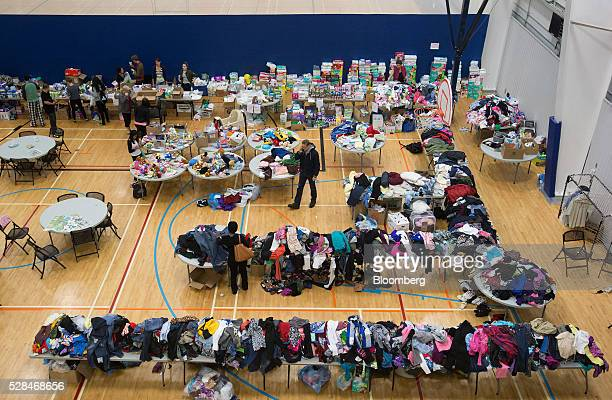 People evacuated due to wildfires in the Fort McMurray area browse through clothing donations and other supplies at a community centre in Lac La...