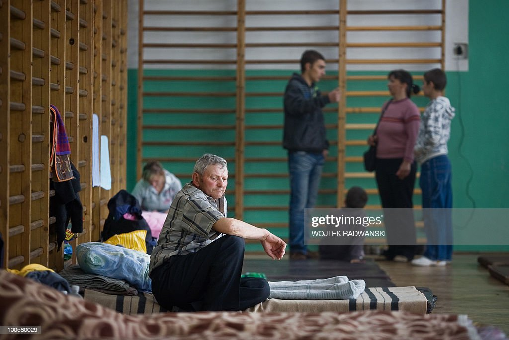 People evacuated from flooded area of Swiniary village are housed in the school gym in Slubice, on May 25, 2010. Torrential rain in Poland's mountainous south have caused rivers, including the Vistula, Poland's largest, swell to levels unseen in more than a century.