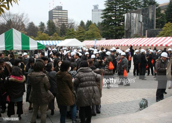 People evacuating gather at a park after a massive earthquake off the coast of Japan at Sendai city in Fukushima prefecture on March 11 2011 massive...