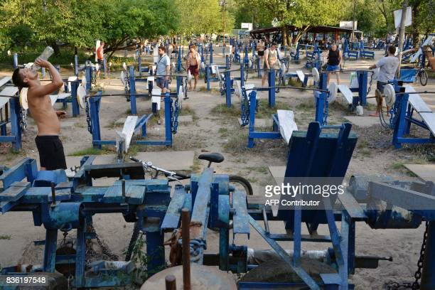 People exercise on August 18 2017 at an open air gym in Ukraine's capital Kiev Foundedin the 1970s the busy open air gym called Kachalka in...