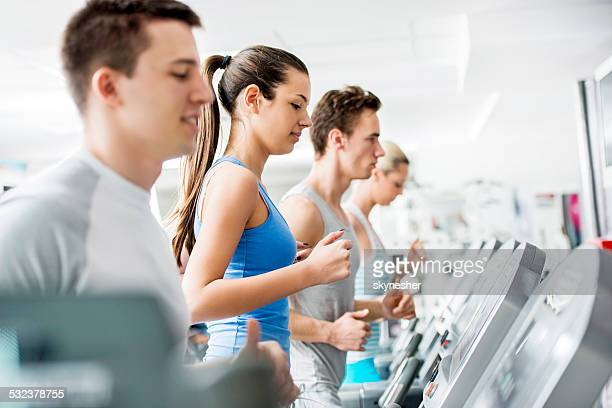 People exercising in a gym.