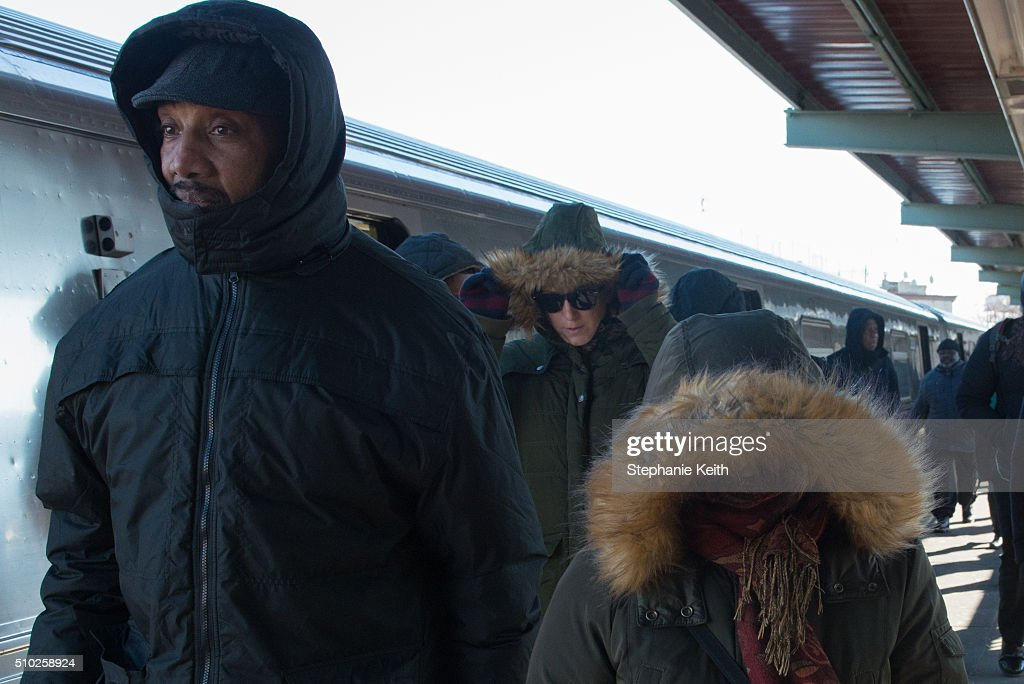 People exit a subway train during an arctic chill that brought frigid temperatures on February 14, 2016 in the Brooklyn borough of New York City.