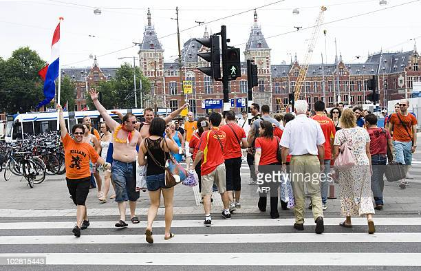 People exit Amsterdam Central Station towards the centre on July 11 2010 to watch on screens the 2010 World Cup football final match opposing Spain...