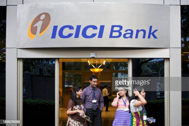 People exit an entrance of ICICI Bank Ltd's head office in Mumbai India on Monday June 3 2013 ICICI Bank India's largest private lender predicts...
