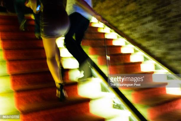 People exit on the red carpeted stars of The Living Room downtown at 1008 Vermont Ave NW Northwest Washington DC is the city's largest quadrant of...