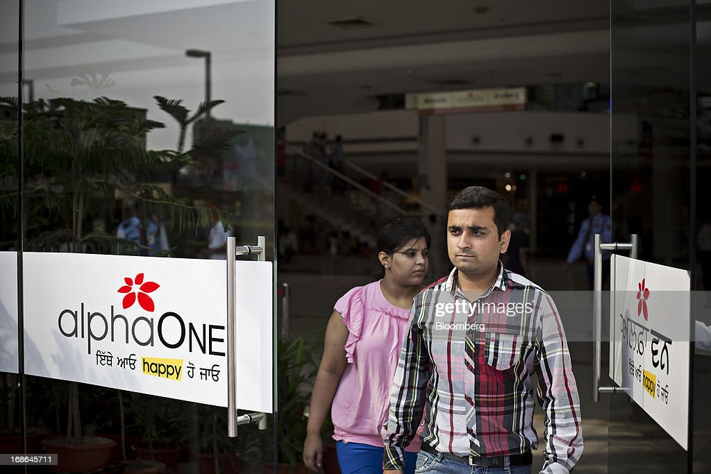 People exit the AlphaOne shopping mall in Amritsar, India, on Thursday, May 9, 2013. India's consumer price index (CPI) for April rose 9.39 percent year on year, the Central Statistics Office said in a statement on its website. Photographer: Brent Lewin/Bloomberg via Getty Images