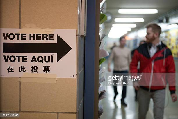 People exit the building after voting at Public School 321 on April 19 2016 in the Brooklyn borough of New York City Voters are going to the polls in...