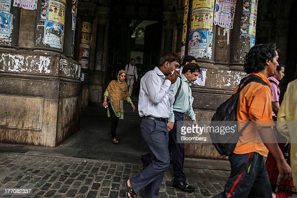 People exit the Chhatrapati Shivaji Terminus railway station during the morning rush hour in Mumbai India on Tuesday Aug 20 2013 Indias biggest...