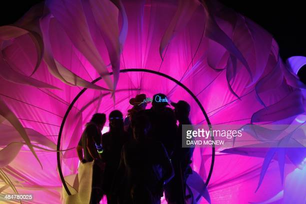People exit the CryoChrone art exhibit at the Coachella Valley Music Arts Festival at the Empire Polo Club in Indio California April 13 2014 The...