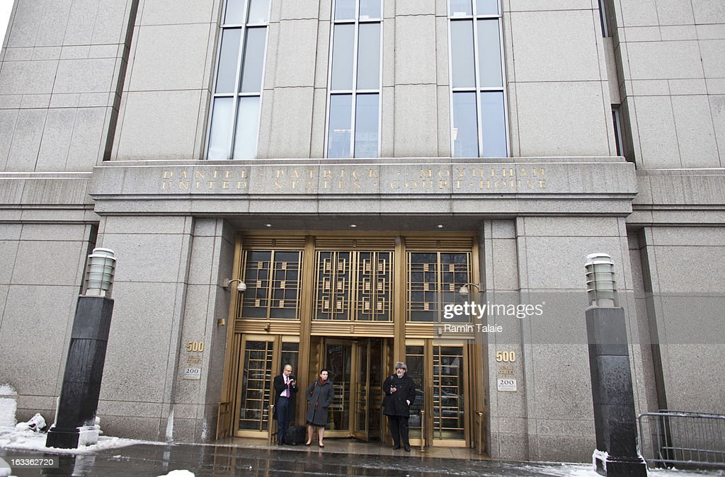People exit the Daniel Patrick Moynihan United States Court House where Sulaiman Abu Ghaith was arraigned on March 8, 2013 in New York City. Abu Ghaith, a son-in-law of Osama bin Laden and former associate, plead not guilty at his arraignment on charges of conspiracy to kill Americans.