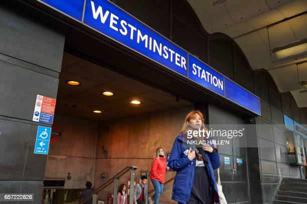 People exit the reopened Westminster London Underground station opposite the Houses of Parliament in central London on March 24 2017 two days after...
