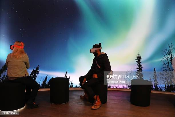 People experience Google's new Daydream View VR headset at a New York City popup shop on October 19 2017 in New York City The temporary store in the...
