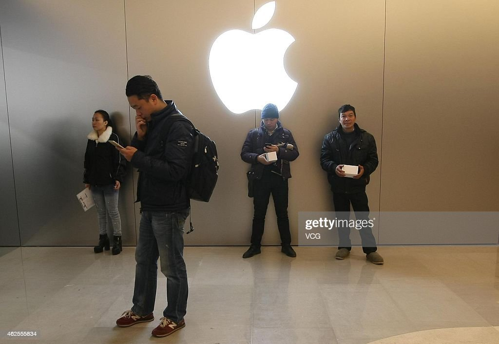 People experience in new Apple Store at Jiefangbei in Yuzhong District on January 31 2015 in Chongqing Sichuan province of China The design of...