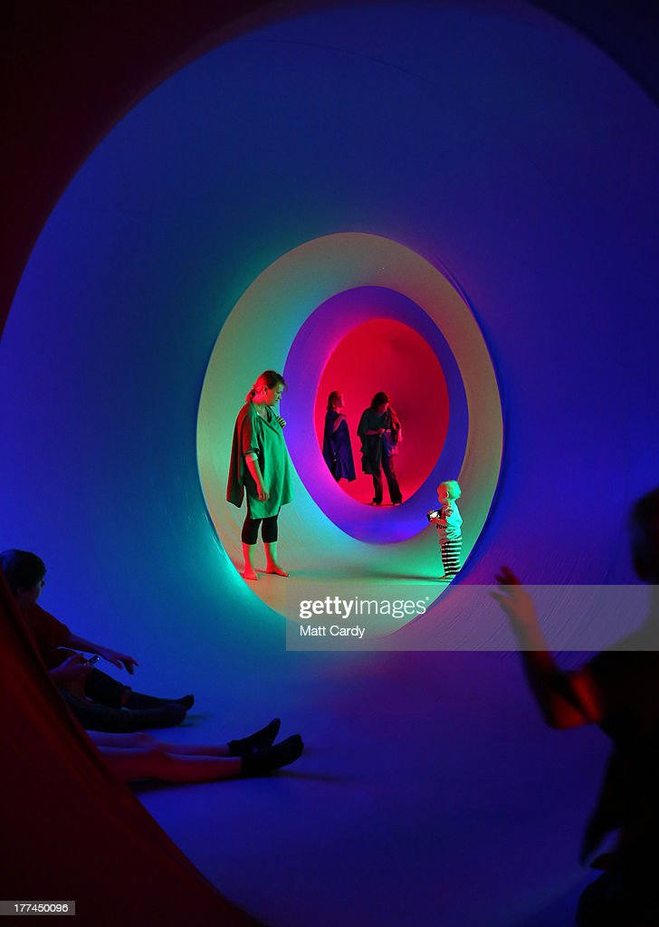 People explore Colourscape on the front lawn of Holburne Museum on August 23, 2013 in Bath, England. The Colourscape Music Festival, which runs until August 26, sees the return of the Colourscape Moonorooni structure, which is a labyrinth of inflatable interconnected chambers flooded with coloured light forming a walk-in sculpture of colour, light and sound. Following on from last year's sell-out audiences, Colourscape presented by Holburne Museum and the Eye Music Trust, will also feature a programme of contemporary music this weekend.