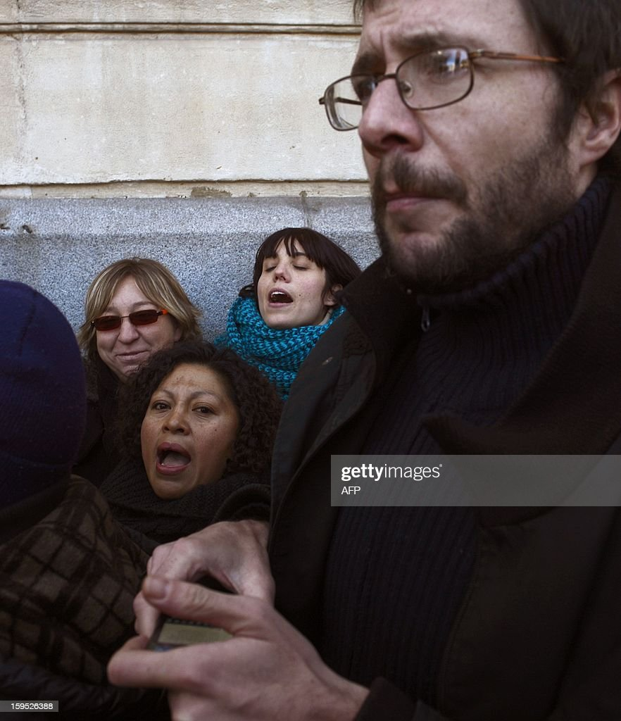 People facing foreclosure protest in front of the building where the Spain Investors Day (SID) forum is being held on January 15, 2013 in Madrid. Three people facing evictions had already committed suicide in Spain since october 2012.