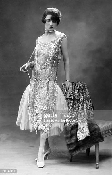1926 Young woman in the evening wear fashion of the era