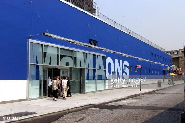 People file into the new Museum of Modern Art Queens along 33rd Street near the corner of Queens Boulevard during the press preview of the grand...