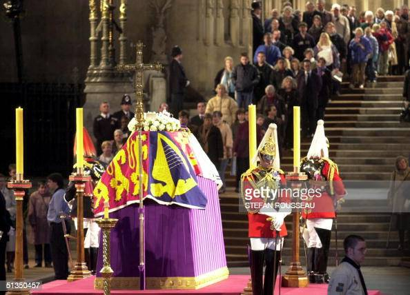People file past the coffin of Queen Elizabeth The Queen Mother covered with her personal standard and guarded by Life Guards 08 April 2002 in...