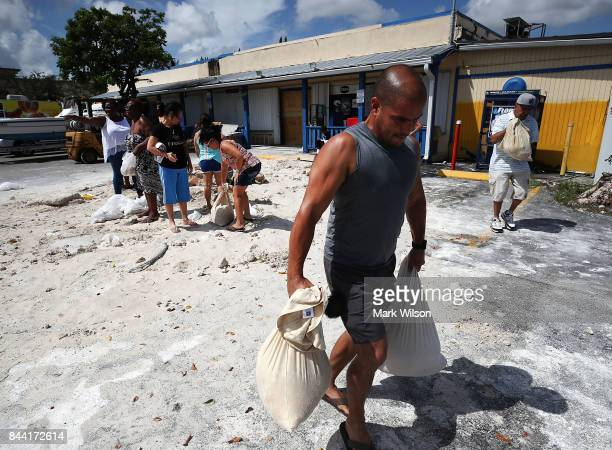 People fill bags with sand as they prepare for the approaching Hurricane Irma on September 8 2017 in Homestead Florida Current tracks for Hurricane...