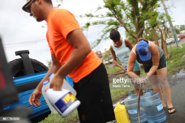 People fill bottles with water provided at a pump by water authorities on October 15 2017 in Dorado Puerto Rico A CNN team found that contaminated...
