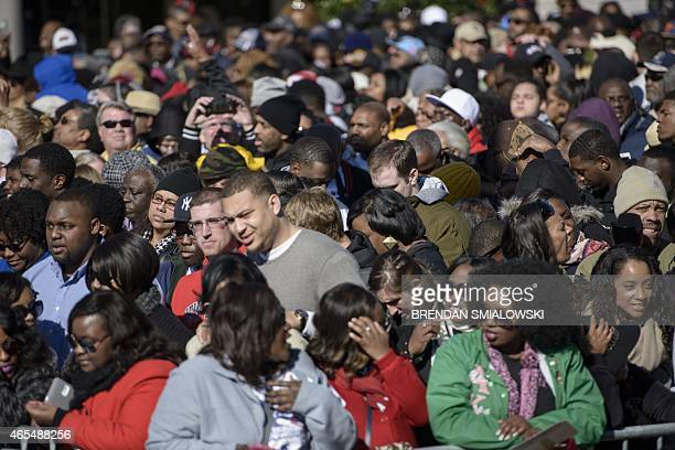 People fill Broad Street while waiting for an anniversary event at the Edmund Pettus Bridge March 7 2015 in Selma Alabama US President Barack Obama...