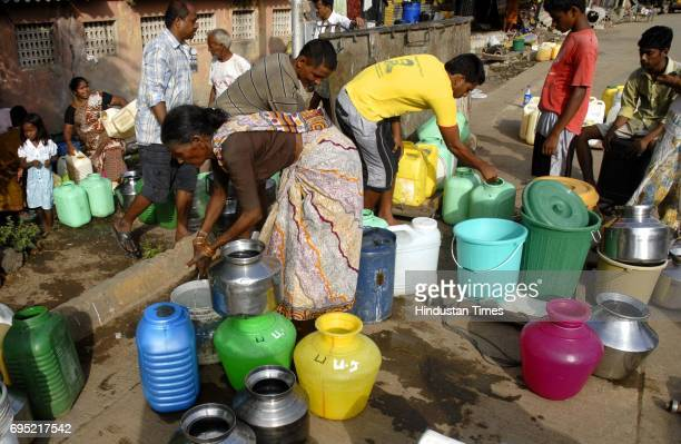 People fill in water to store at Prabhadevi as areas in SouthCentral Mumbai faces a 25% watercut from Monday due to the work which begin on replacing...