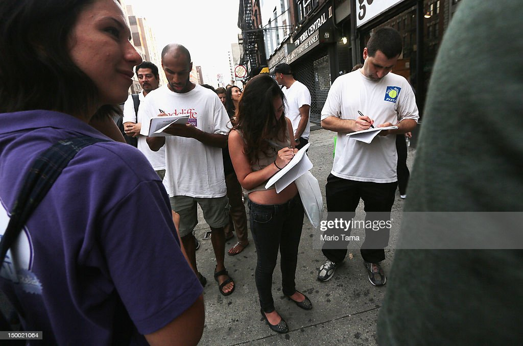 People fill out forms to receive free vibrators from Trojan in Manhattan on August 8, 2012 in New York City. The company handed out some vibrators earlier in the day but collected email addresses after the promotion was shut down for reasons that remain unclear.