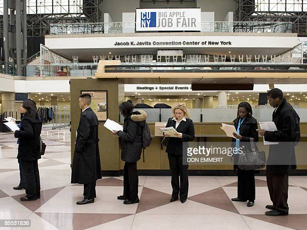 People fill out questionnaires as they line up to try for jobs at the City University of New York's Big Apple Job Fair March 20 2009 at the Jacob...