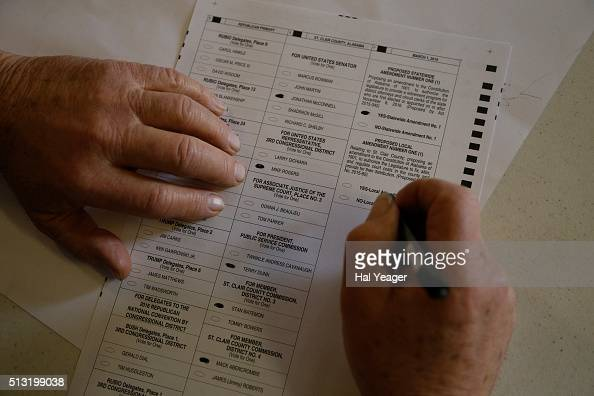 People fill out their ballots in today's Super Tuesday election at the Shoal Creek Community Center in Shoal Creek Alabama 13 states and American...