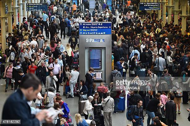 People fill the Eurostar terminal at St Pancras station in London on June 23 2015 after disruption on the French side of the Channel Tunnel caused...