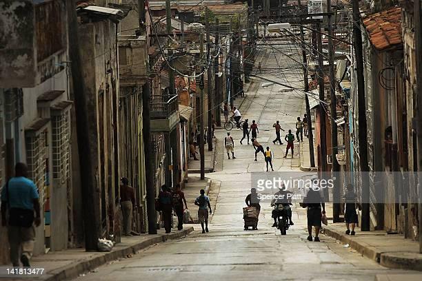 People fill the street in a busy downtown neighborhood on March 24 2012 in Santiago de Cuba Fourteen years after Pope John Paul II visited Cuba Pope...