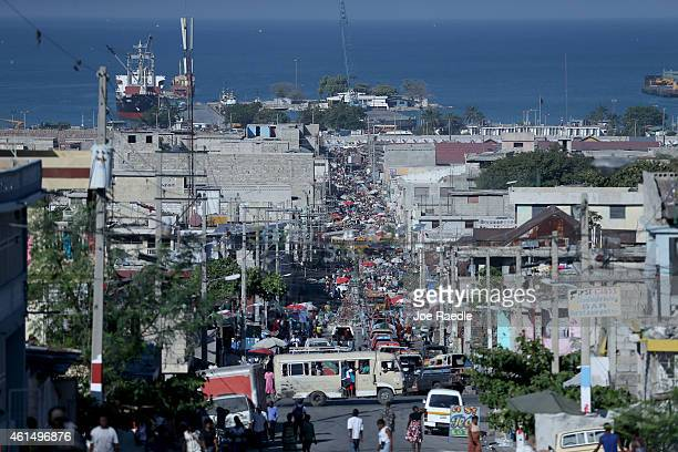 People fill the streets in an open air market as Haiti continue to rebuild and reestablish its daily routines after the five year anniversary of the...