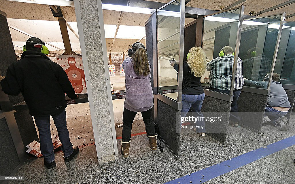 People fire guns at the 'Get Some Guns & Ammo' shooting range on January 15, 2013 in Salt Lake City, Utah. Lawmakers are calling for tougher gun legislation after recent mass shootings at an Aurora, Colorado movie theater and at Sandy Hook Elementary School in Newtown, Connecticut.