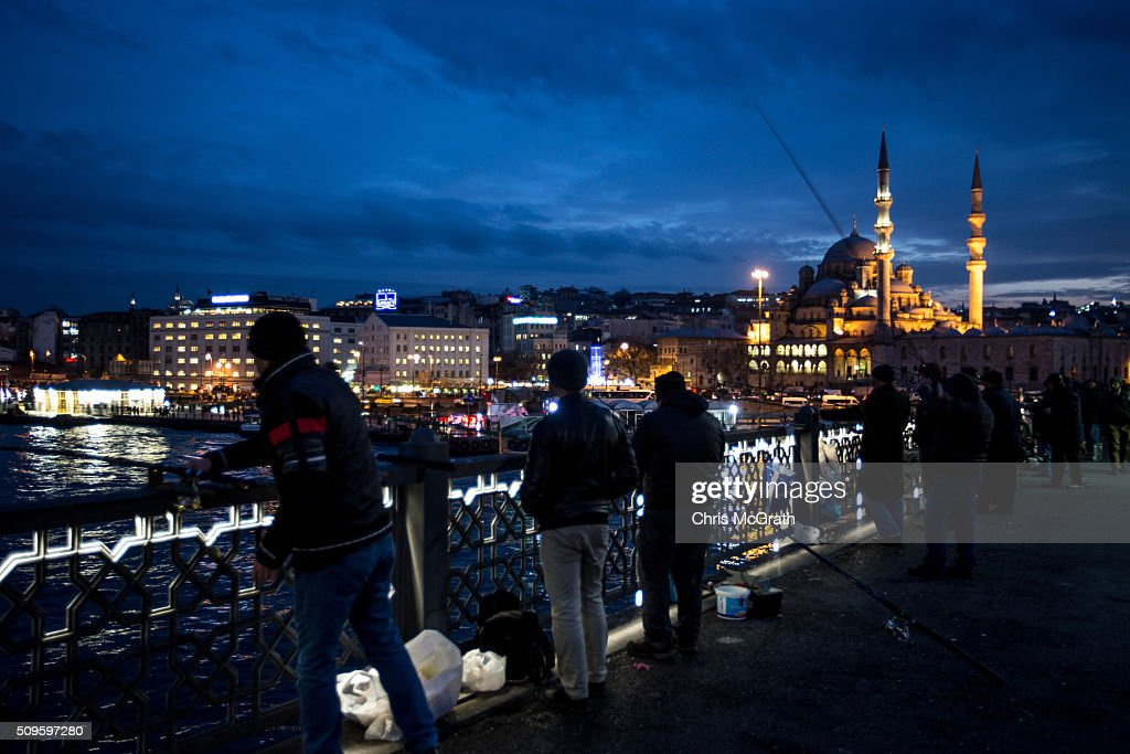 People fish in front of the Eminonu Mosque on February 11, 2016 in Istanbul, Turkey. Istanbul is famous for its skyline dotted with historic mosques, it is home to more than 3000 mosques, the most of any city in Turkey and includes the famous Blue Mosque and Suleymaniye Mosque.