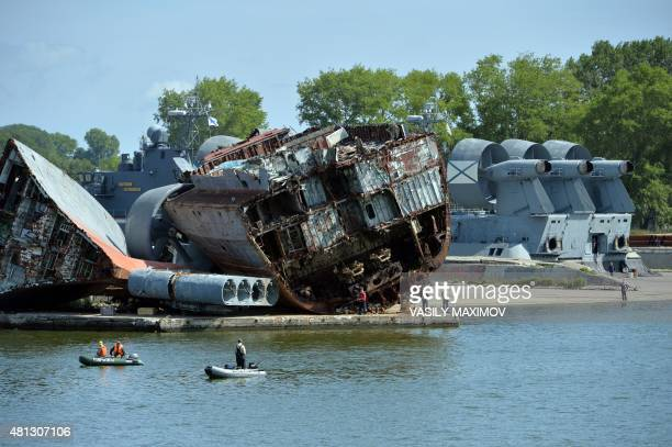People fish in front of wrecked ships at the Russian Navy and Fleet base in Baltiysk on July 19 2015 Kaliningrad will host matches during the 2018...