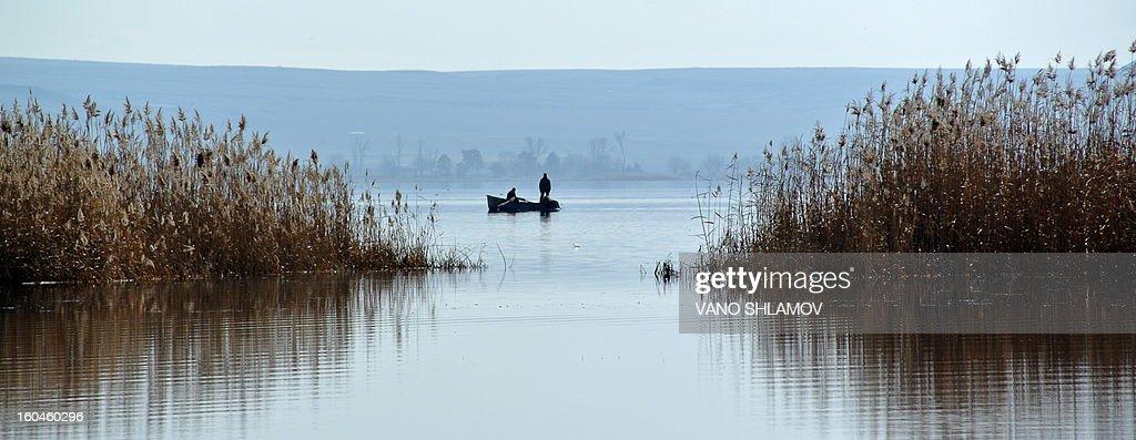 People fishing at the Jandari Lake, some 60 km, outside the Georgia's capital Tbilisi, early on February 1, 2013.