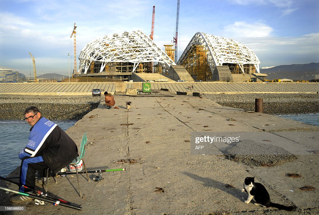 People fishing near the the 'Fisht' Olympic Stadium in the Imereti Valley in the Russian Black Sea resort of Sochi, on December 20, 2012. Sochi will host the 2014 Winter Olympics that start on February 7, 2014 . AFP PHOTO / MIKHAIL MORDASOV