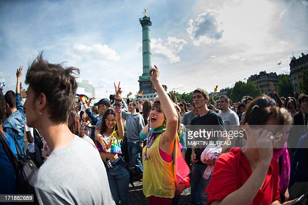 People flash the Victory sign as they gather on the Bastille square during the homosexual lesbian bisexual and transgender visibility march the Gay...