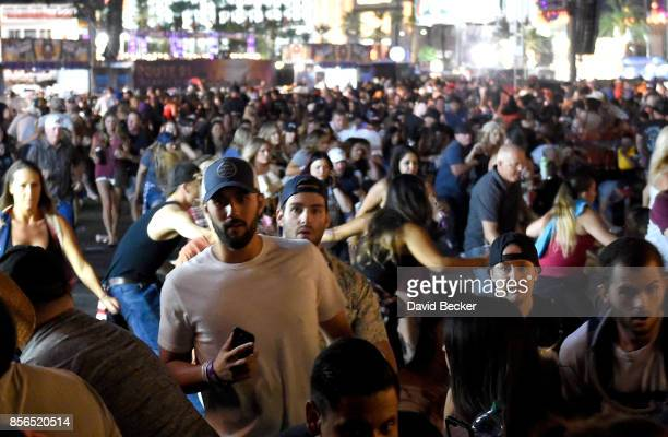 People flee the Route 91 Harvest country music festival grounds after a active shooter was reported on October 1 2017 in Las Vegas Nevada A gunman...