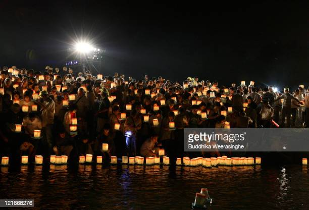 People float lanterns during celebrations for the Obon Festival honouring the spirits of deceased ancestors at Eiheiji on August 21 2011 in Fukui...