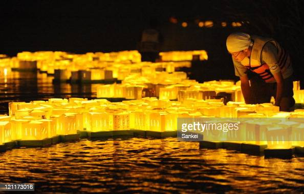 People float paper lanterns to Natori river on August 13 2011 in Natori Miyagi Japan The ceremony is held to mourn the victims of Great East Japan...