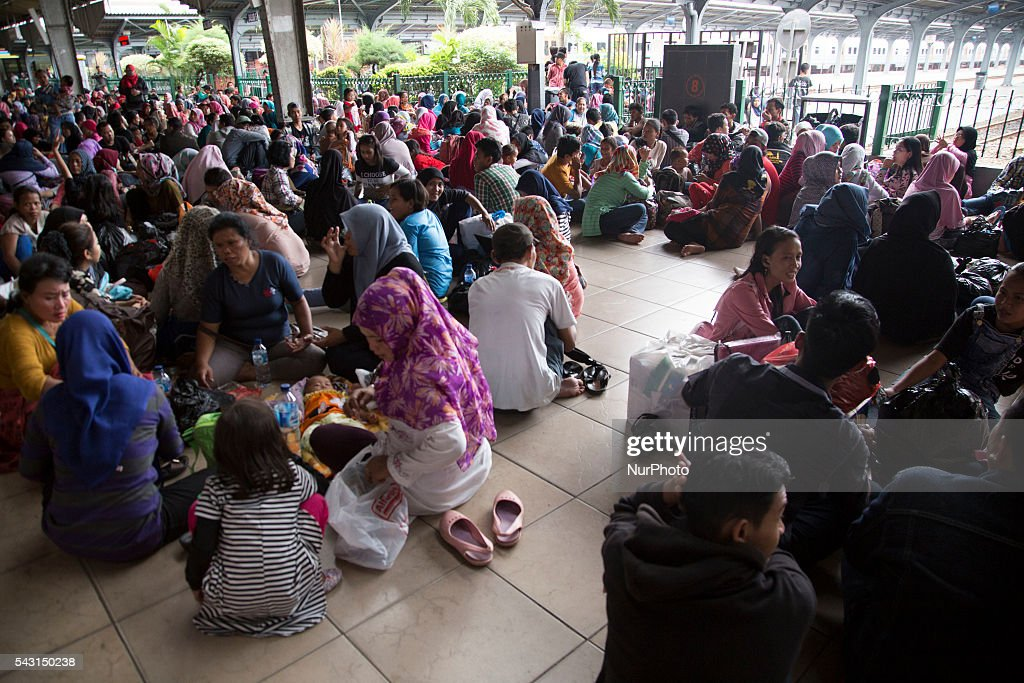 People flock at Kota Station in Jakarta waiting for the train that will bring them to their original place to celebrate Iedul Fitri, on June 26, 2016. Every year people that working in Jakarta will visit their original place in Indonesia to celebrate iedul fitri with their loves ones.